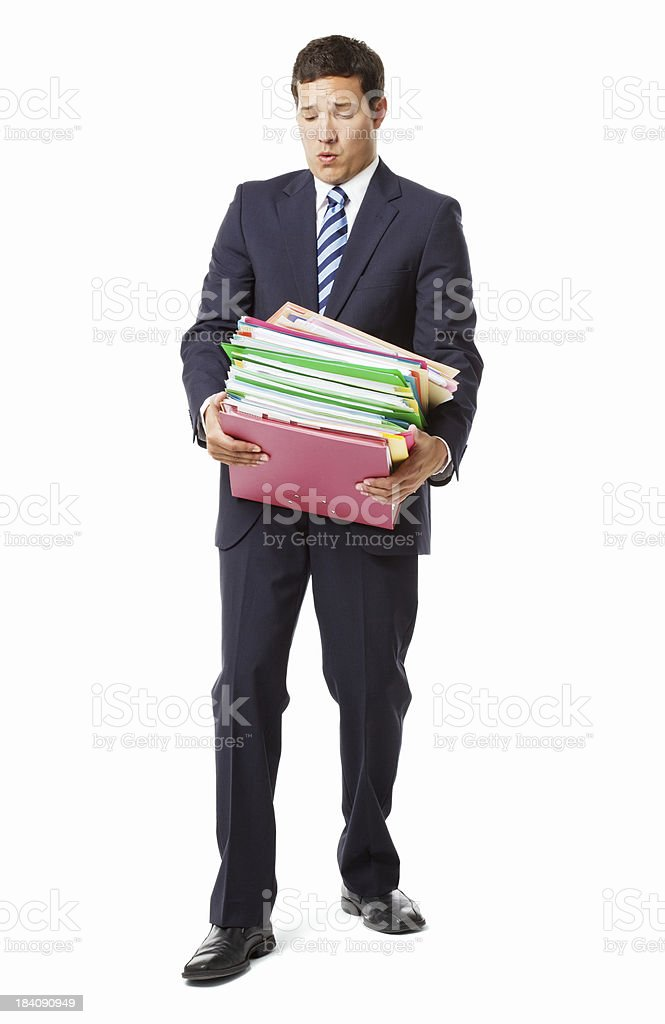 Businessman With a Heavy Workload - Isolated royalty-free stock photo