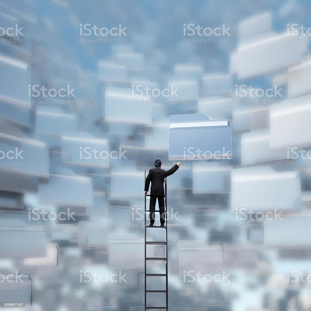 businessman with a ladder and folders stock photo
