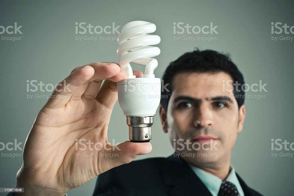 Businessman with a lightbulb royalty-free stock photo