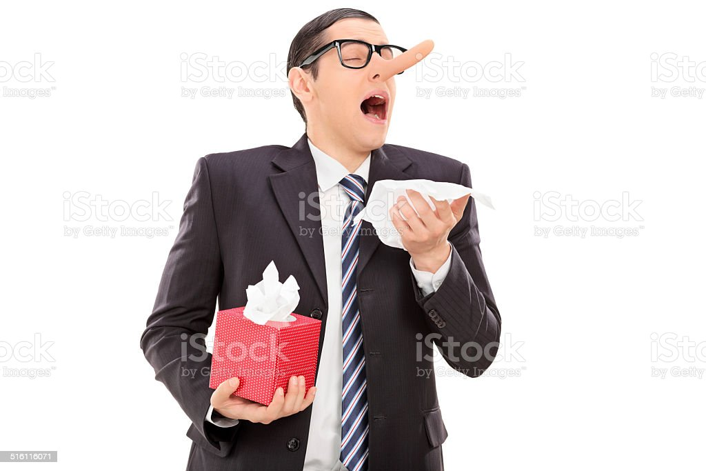 Businessman with a long nose sneezing stock photo