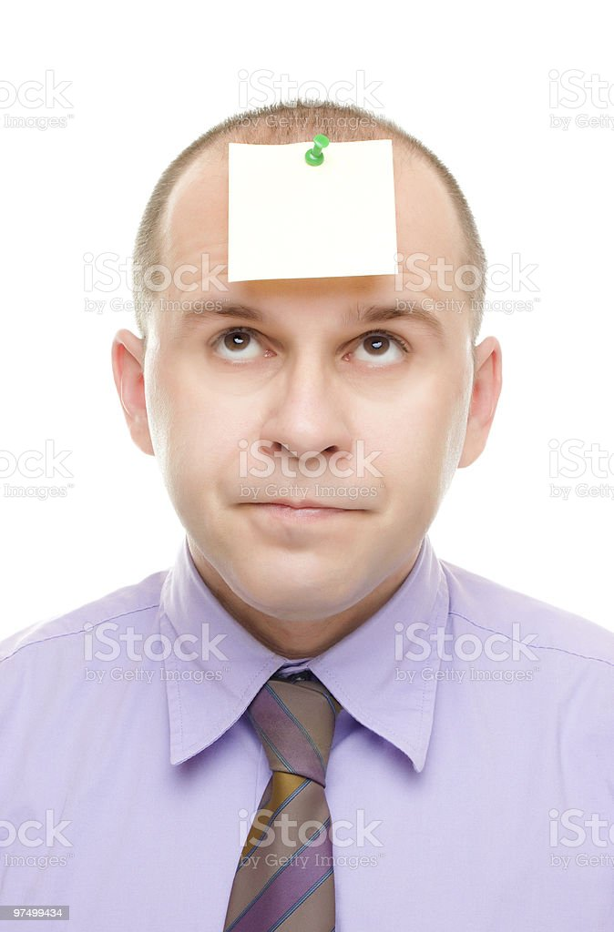 Businessman with a note pinned on his head royalty-free stock photo