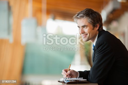 530281733istockphoto Businessman with a planner 519051294