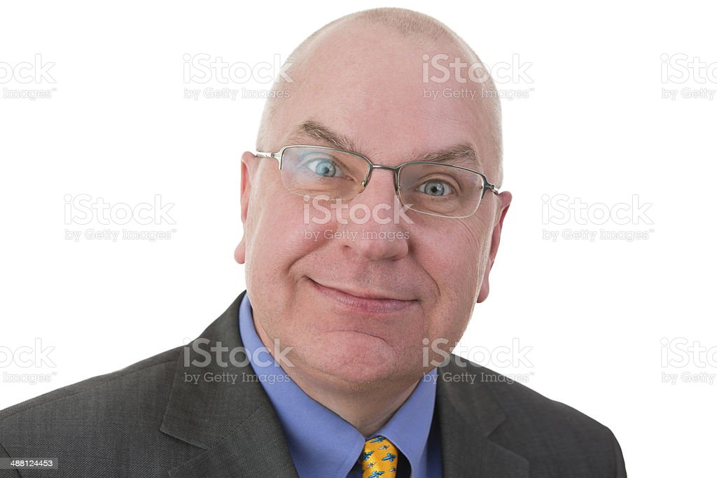 Businessman with a sardonic quizzical expression stock photo