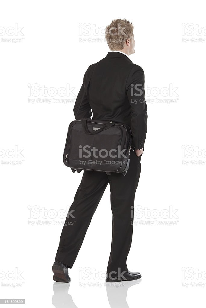 Businessman with a shoulder bag stock photo