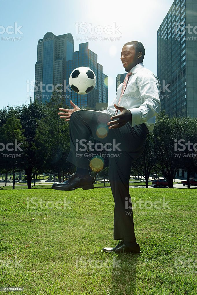 Businessman with a soccer ball stock photo
