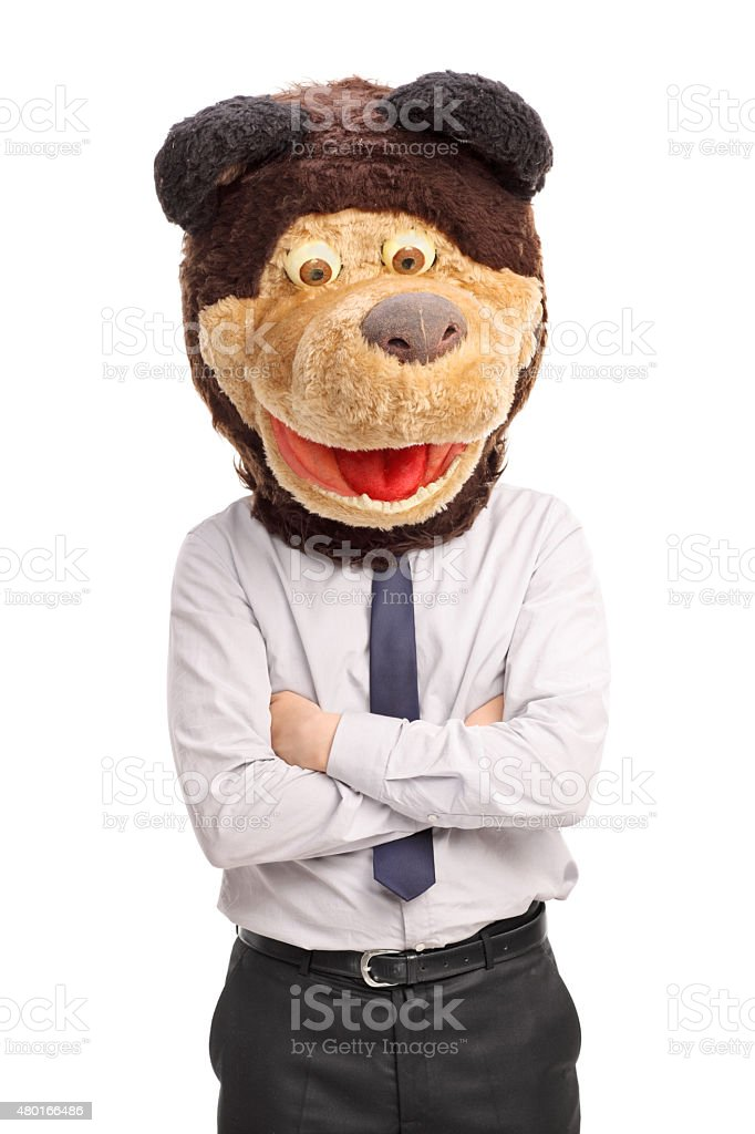 Businessman with a tie wearing a bear mask stock photo