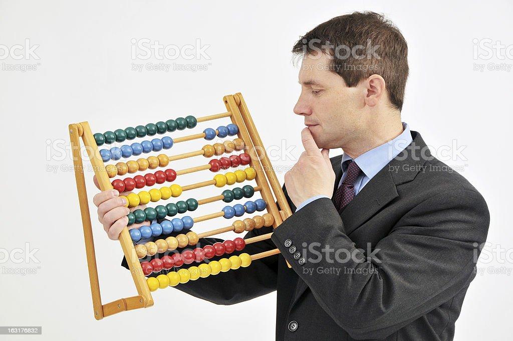 Empresário com ábaco - foto de acervo