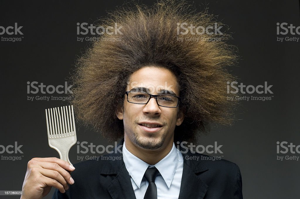businessman with afro hair and comb stock photo