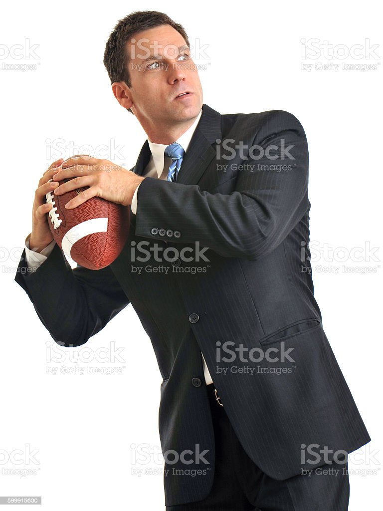 Businessman with American Football on White stock photo