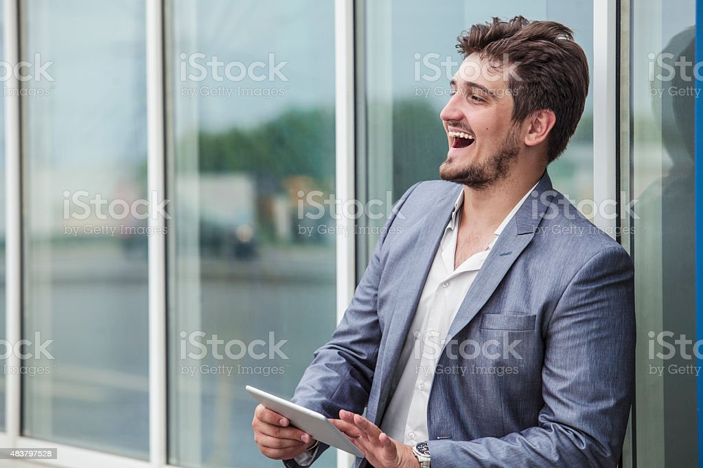 Businessman with an electronic tablet in the urban district stock photo