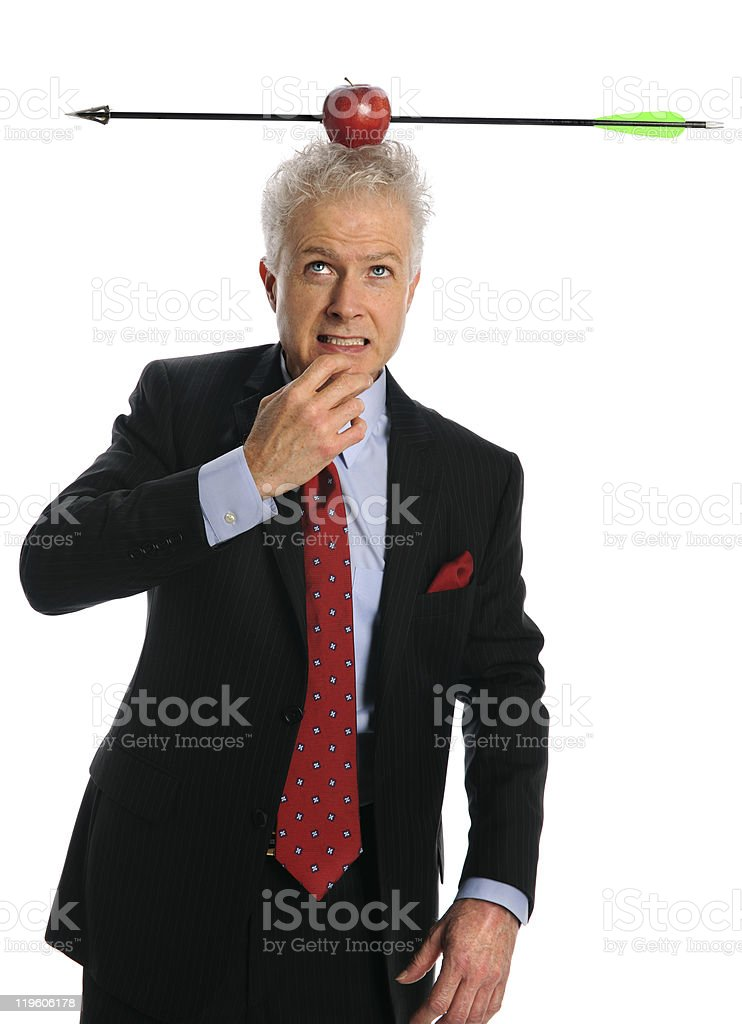 Businessman With Apple and Arrow on Top of Head royalty-free stock photo