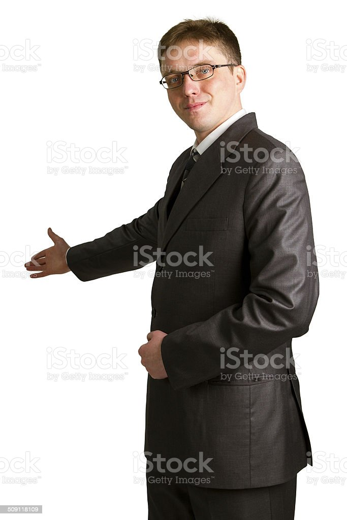 Businessman with arm out in a welcoming gesture stock photo
