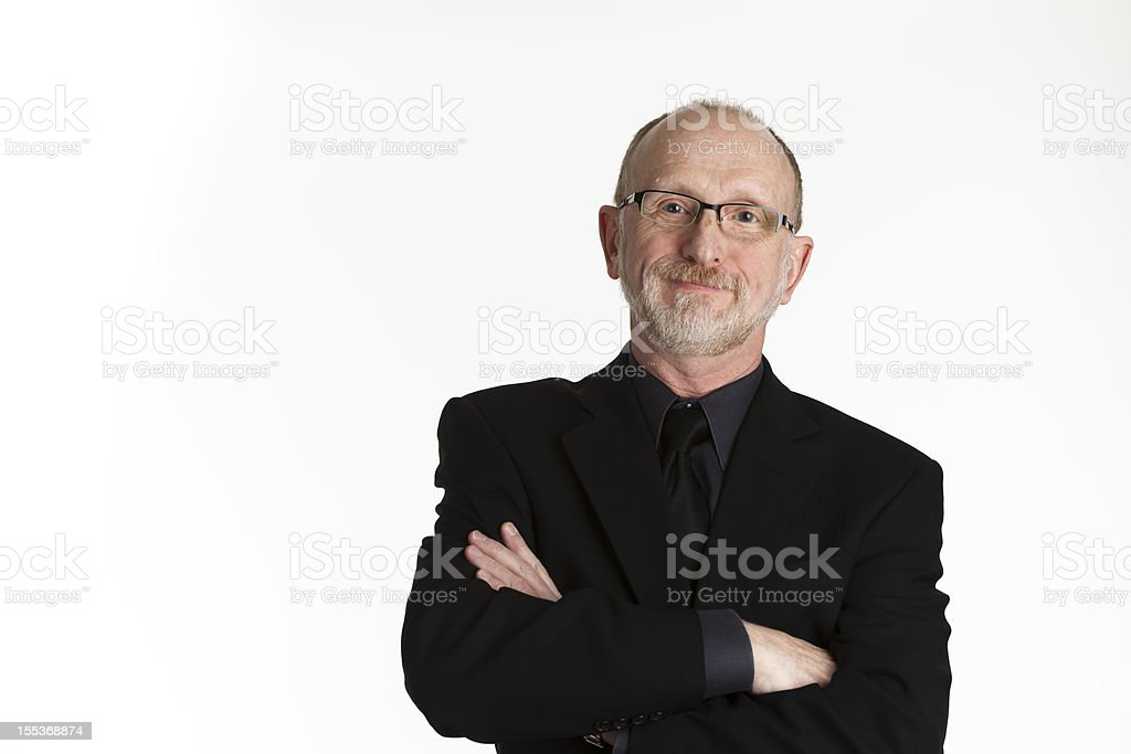 Businessman with Arms Crossed in Black Suit royalty-free stock photo