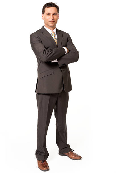 Businessman with Arms Crossed Isolated on White Background Businessman with Arms Crossed Isolated on White Background spokesperson stock pictures, royalty-free photos & images
