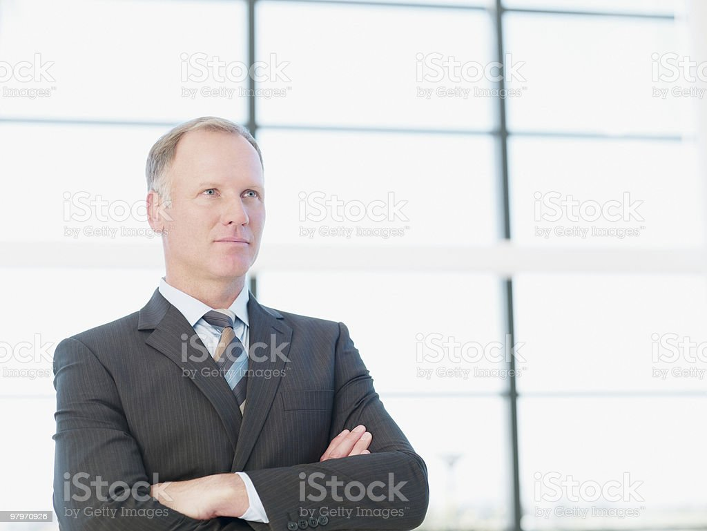 Businessman with arms crossed looking serious royalty-free stock photo