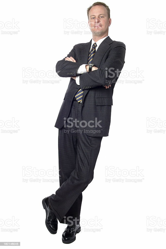 Businessman with arms folded leaning on a white background royalty-free stock photo