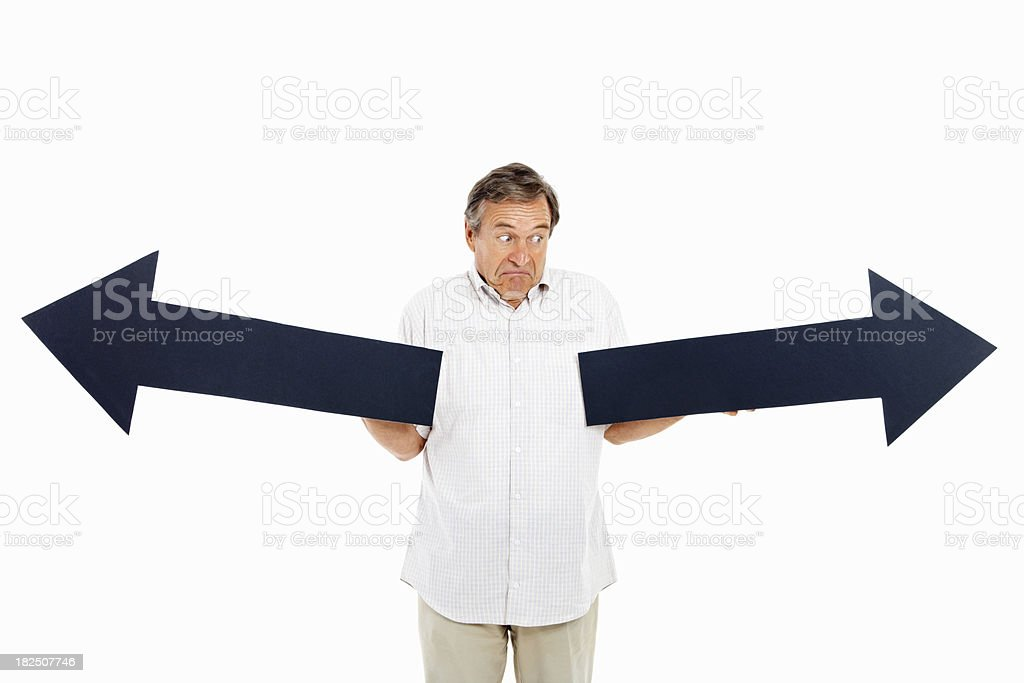 Businessman with arrowsigns royalty-free stock photo