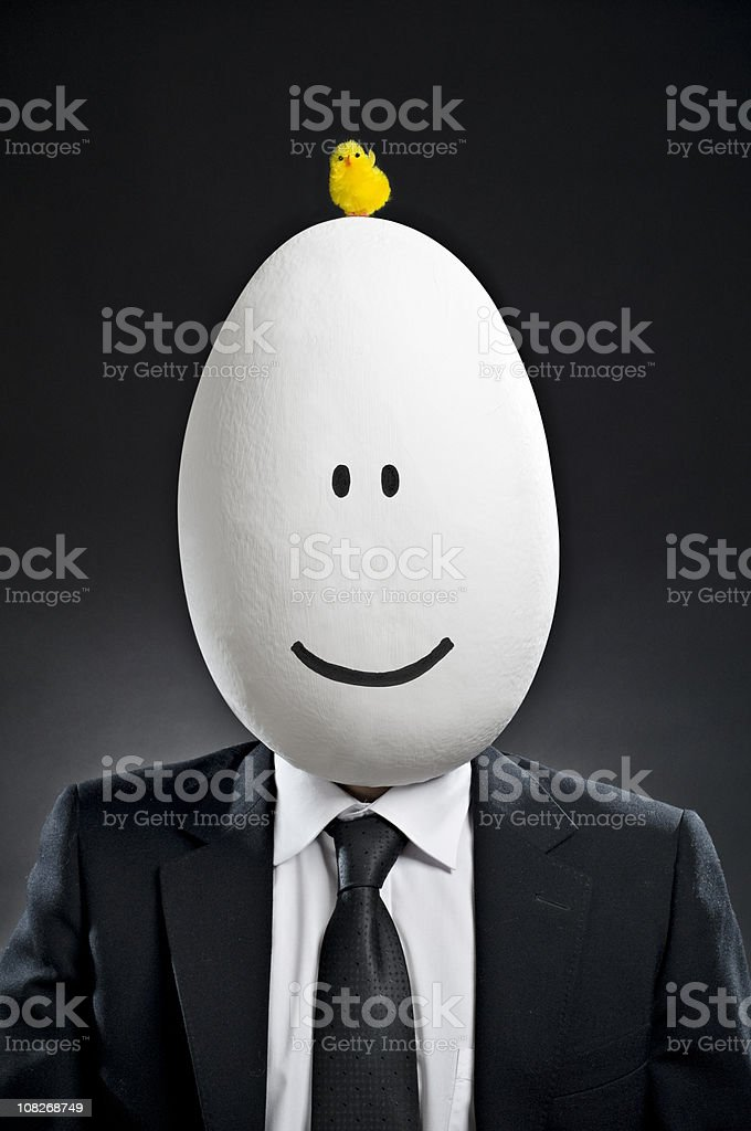 Businessman with Baby Chick on Egg Head royalty-free stock photo