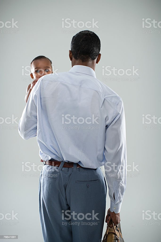 Businessman with baby royalty-free stock photo