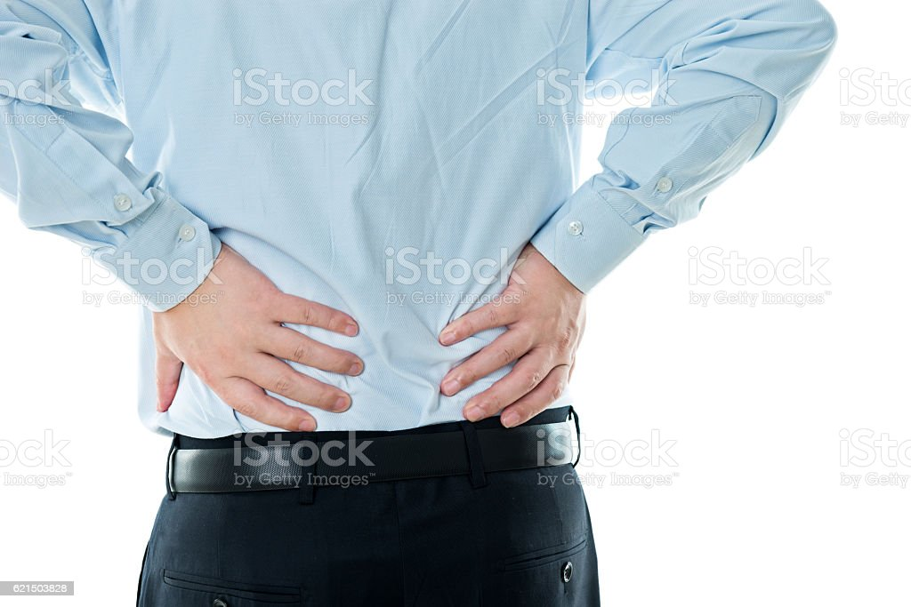 Businessman with backache against white background Lizenzfreies stock-foto