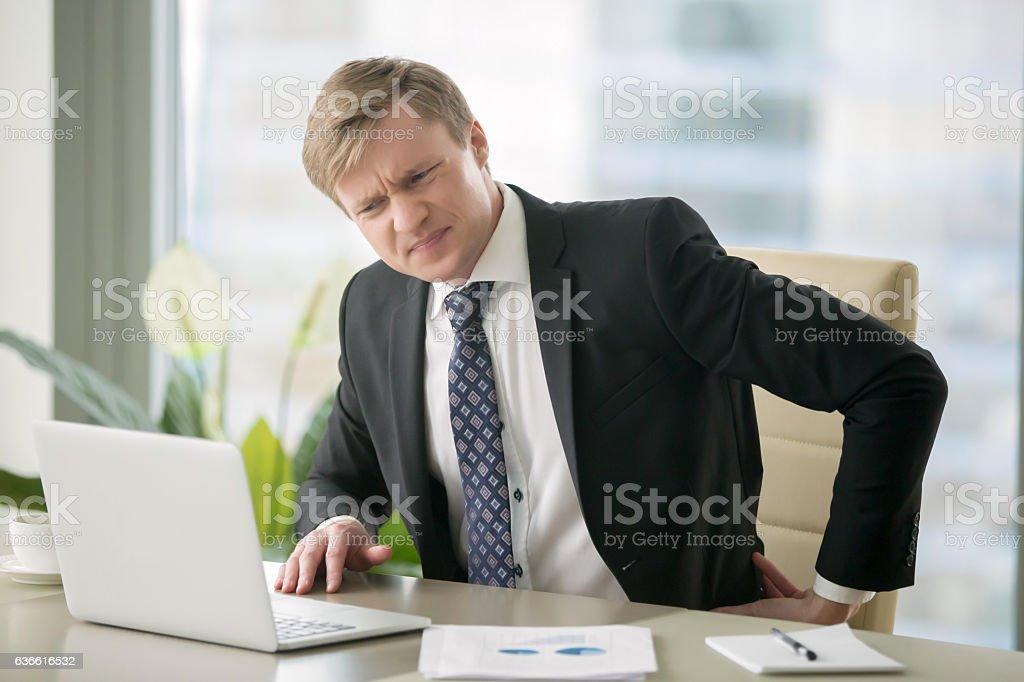 Businessman with backache stock photo