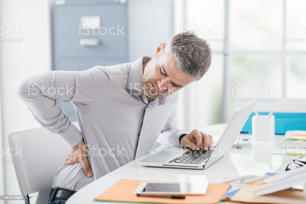 Businessman with backache stock photo