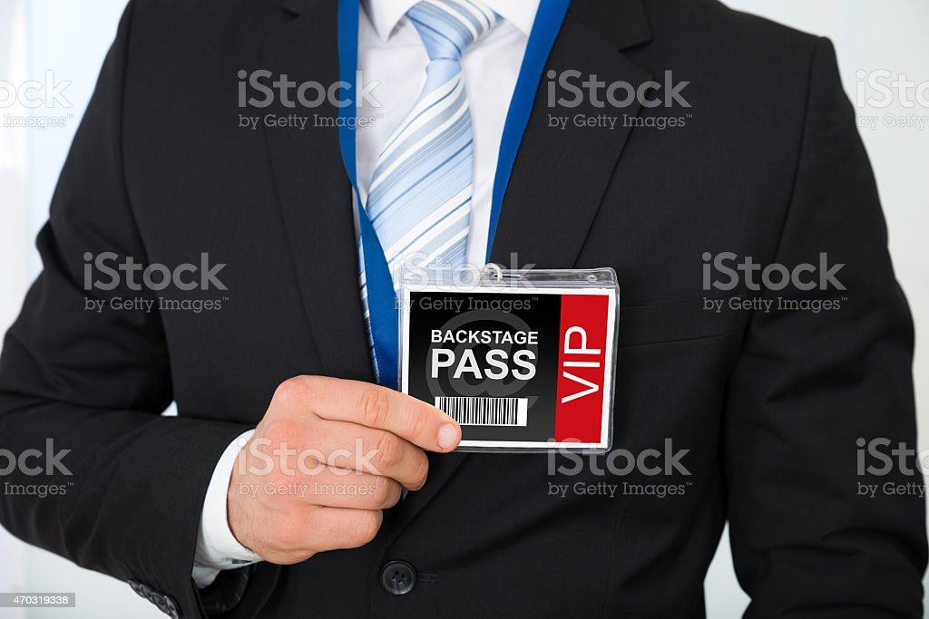Businessman With Backstage Pass stock photo