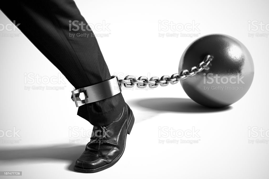 Businessman with Ball and Chain stock photo