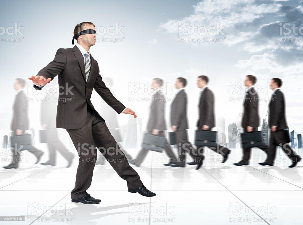 Businessman with bandage on his eyes stock photo
