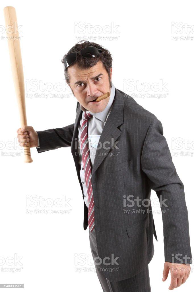 Businessman with baseball bat stock photo