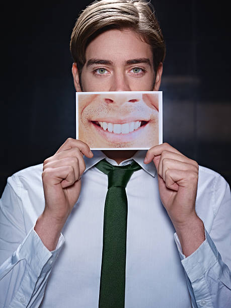 businessman with big mouth smiling at camera stock photo