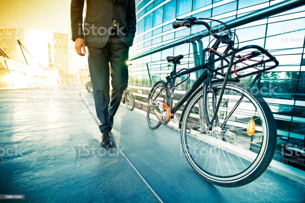 Businessman with bike stock photo