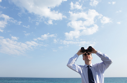 Businessman With Binoculars Stock Photo - Download Image Now
