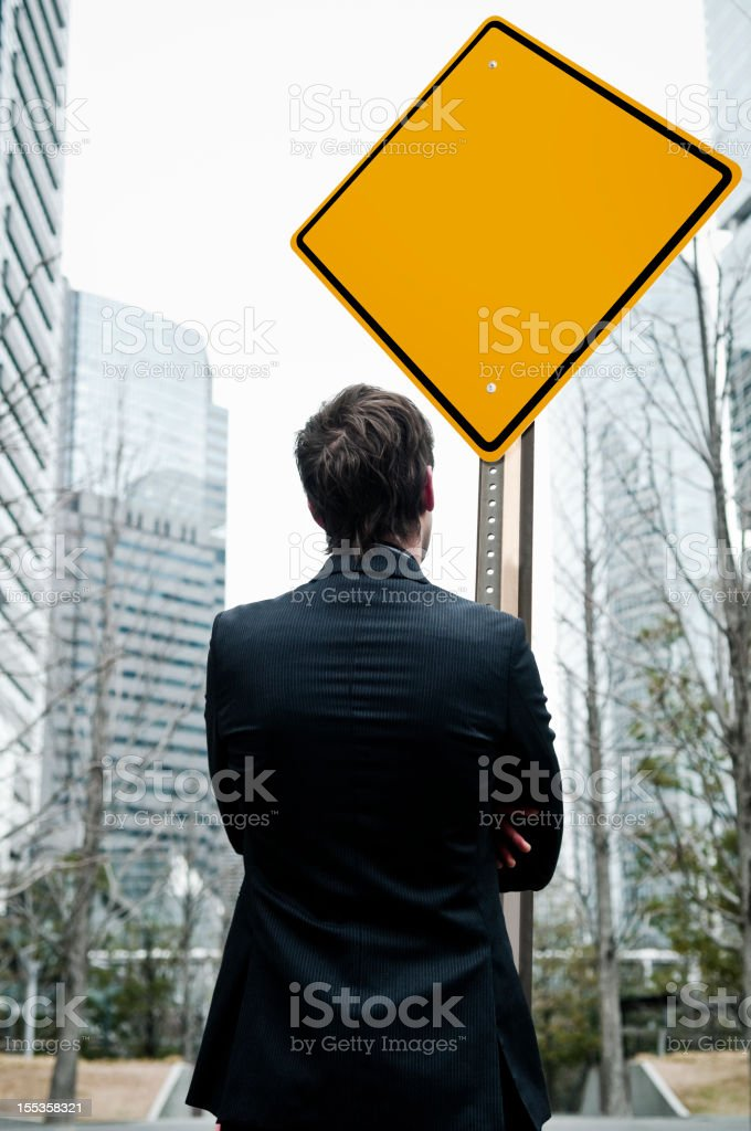 Businessman with blank sign royalty-free stock photo