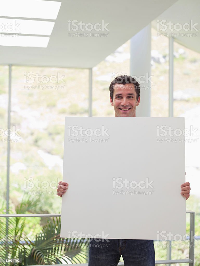 Businessman with blank sign stock photo