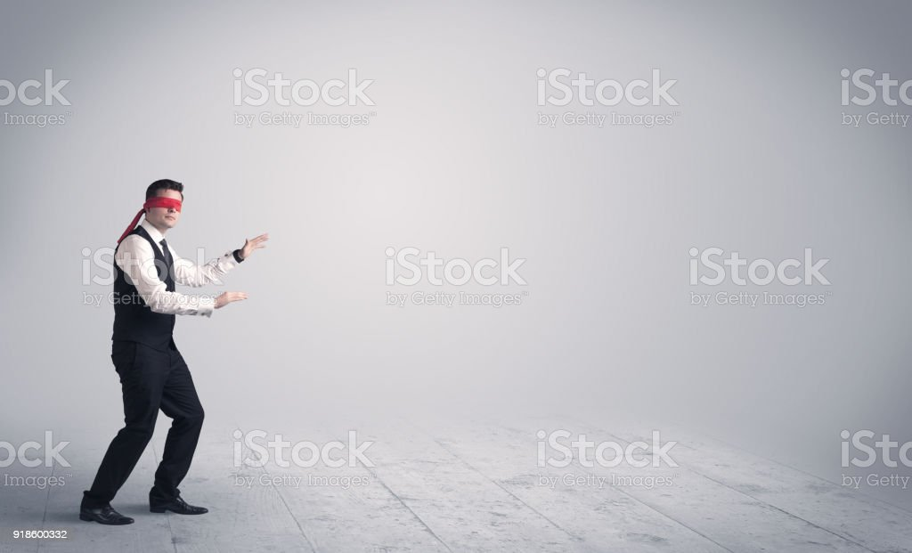 Businessman with blindfolds stock photo