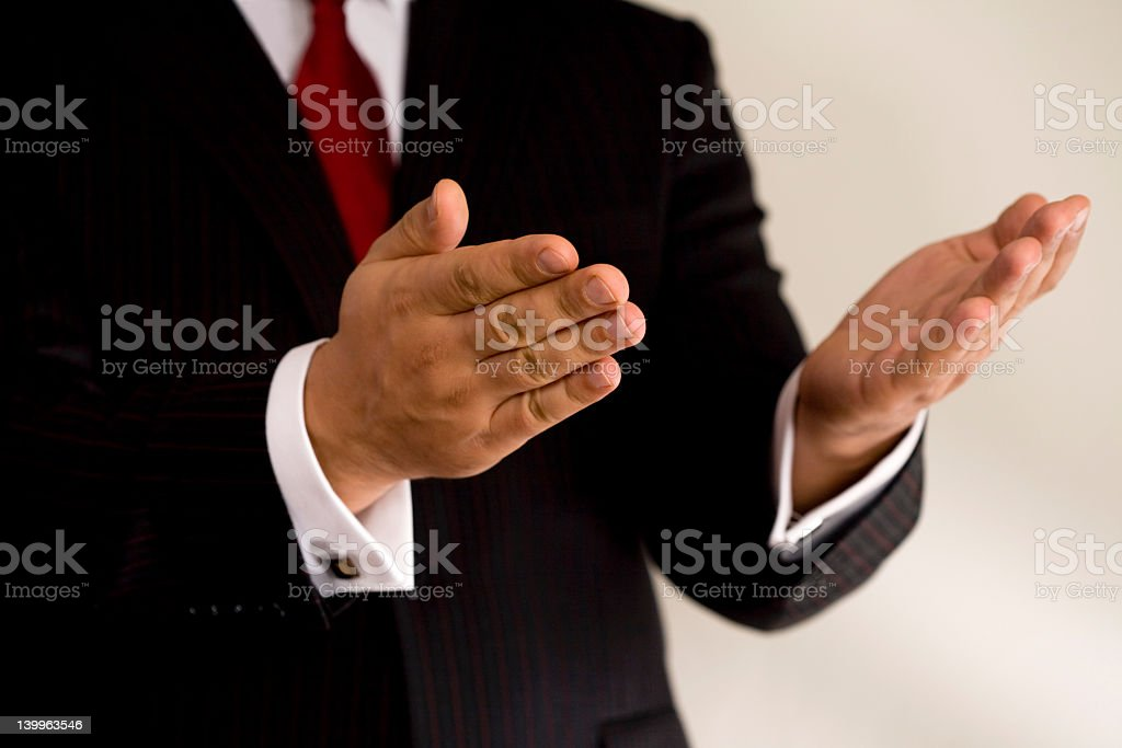 Businessman with both hands in open gesture royalty-free stock photo