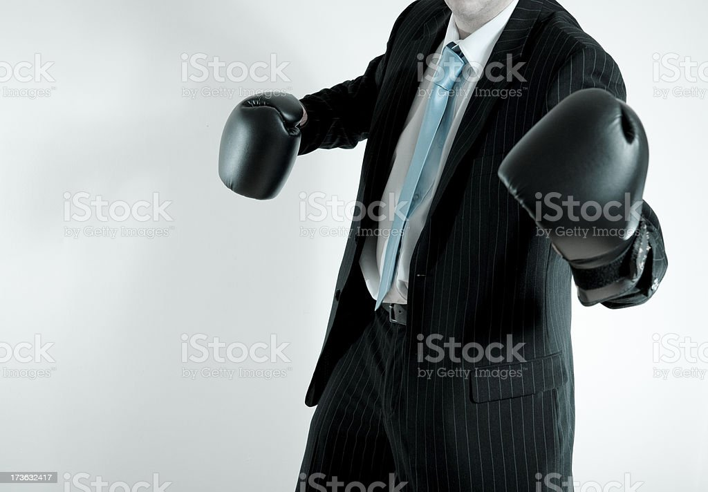 businessman with boxing gloves royalty-free stock photo