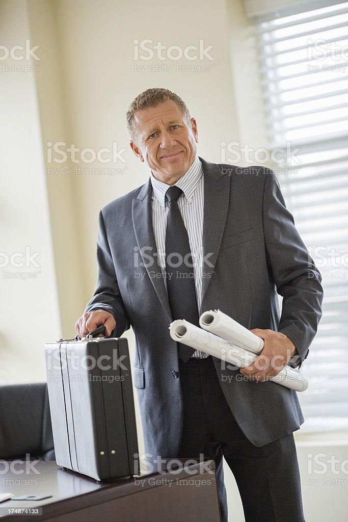 Businessman With Briefcase And Blueprints royalty-free stock photo