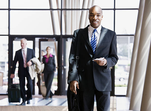 Businessman With Briefcase And Passport stock photo