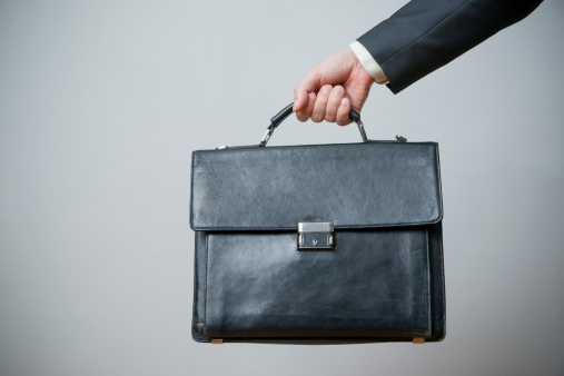 istock Businessman with briefcase in hand 489697817