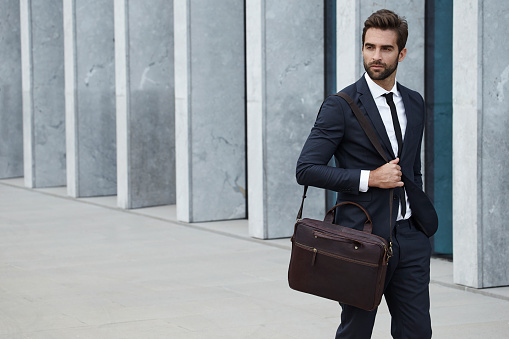 istock Businessman with briefcase 611768440