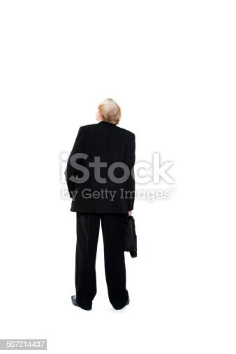 istock Businessman with briefcase shot from behind 507214437
