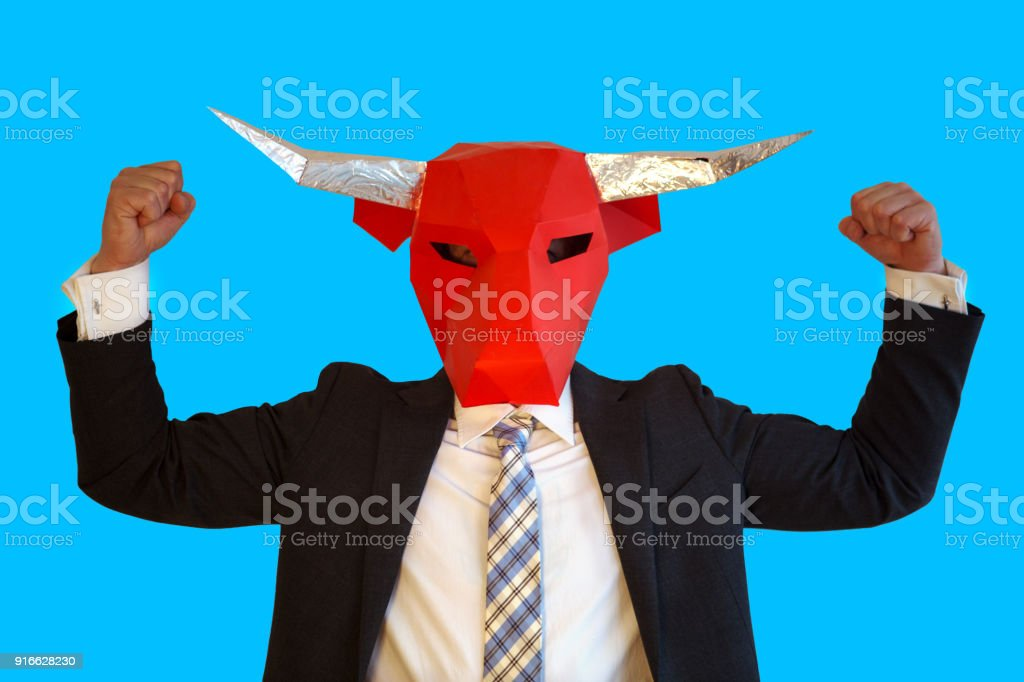 businessman with bull mask flexing his muscles stock photo