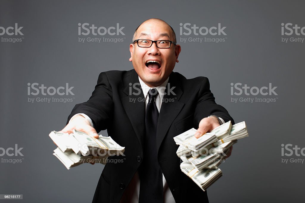 Businessman with bundles of cash royalty-free stock photo