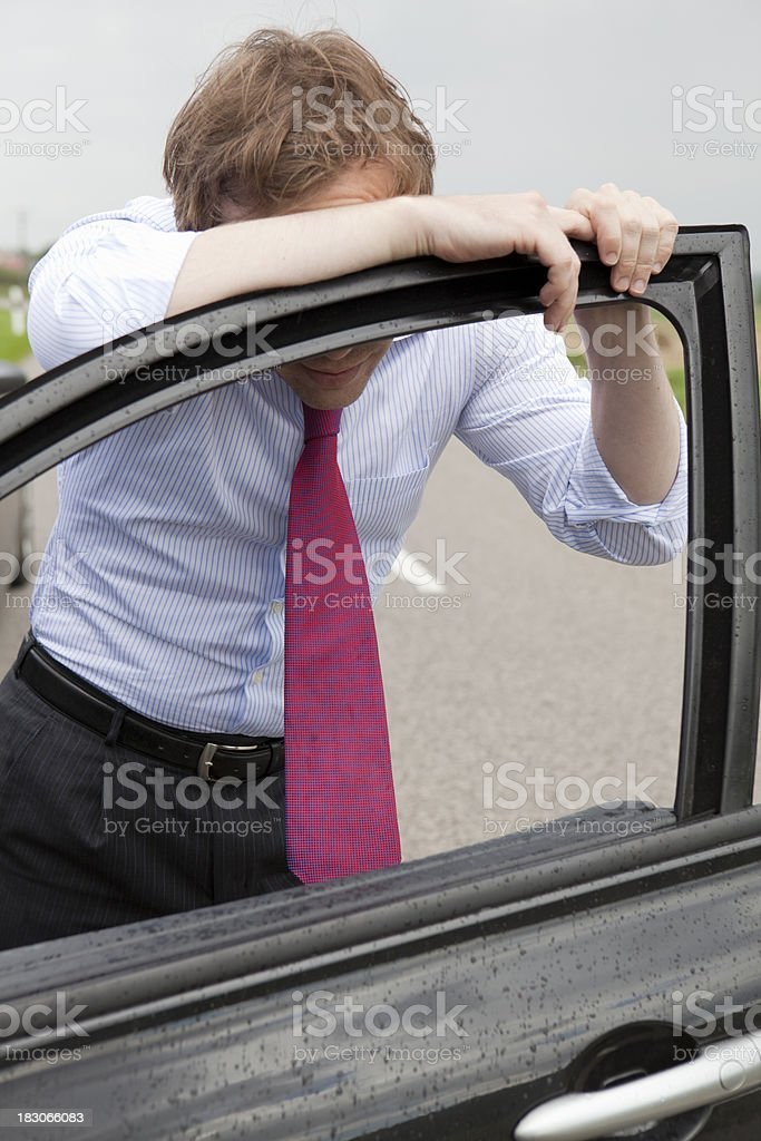 Businessman with car trouble royalty-free stock photo