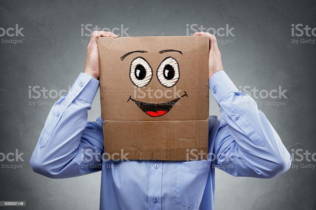 Businessman with cardboard box on his head stock photo