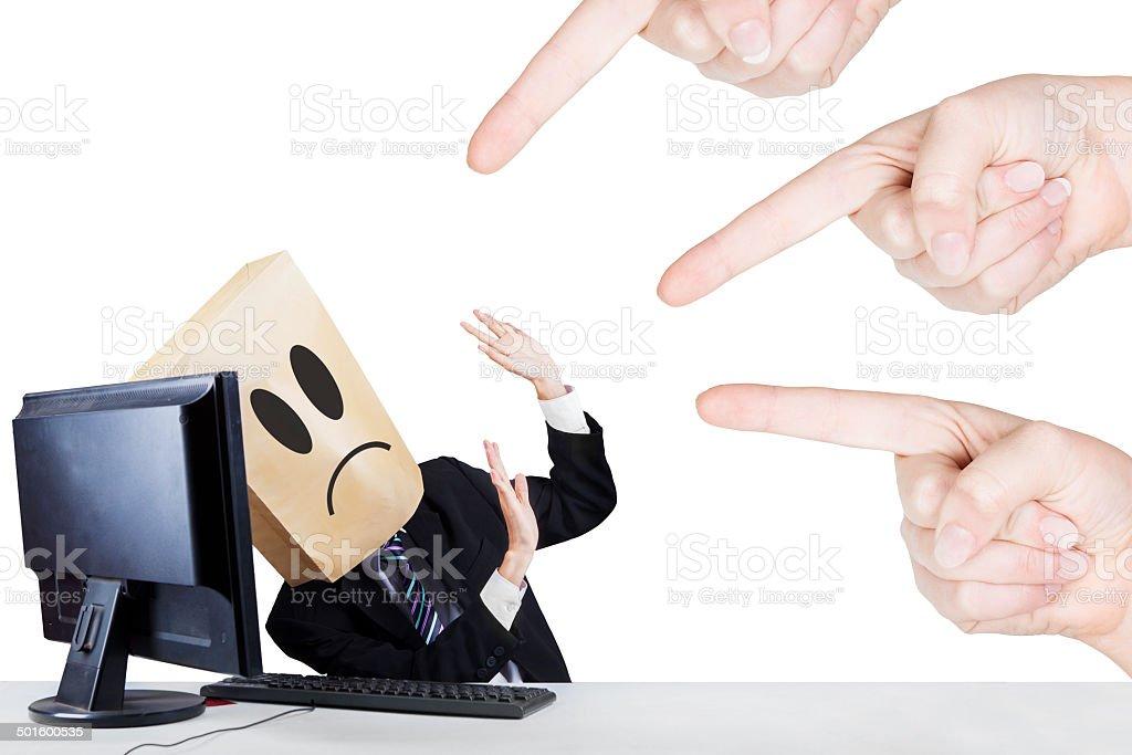 Businessman with carton head bullied stock photo