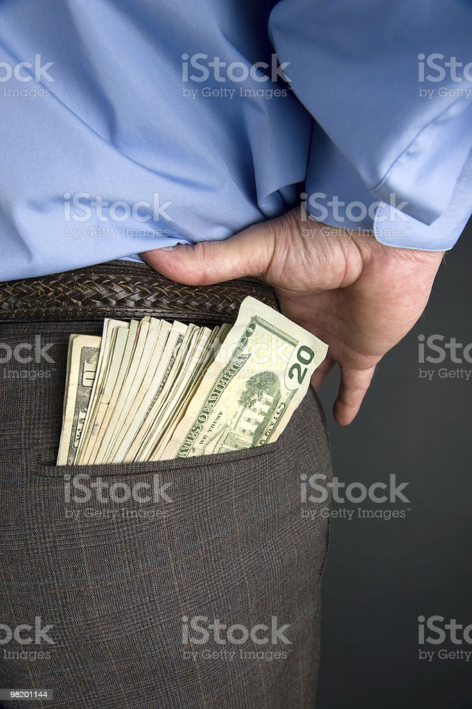 Businessman with cash in back pocket royalty-free stock photo
