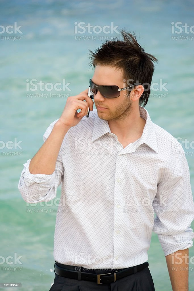 Businessman With Cell Phone by Ocean royalty-free stock photo